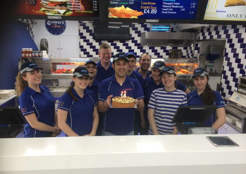 Staff at George's fish and chip shop in Bourne celebrate the 14th anniversary of the businesses by raising money for The Butterfield Centre.