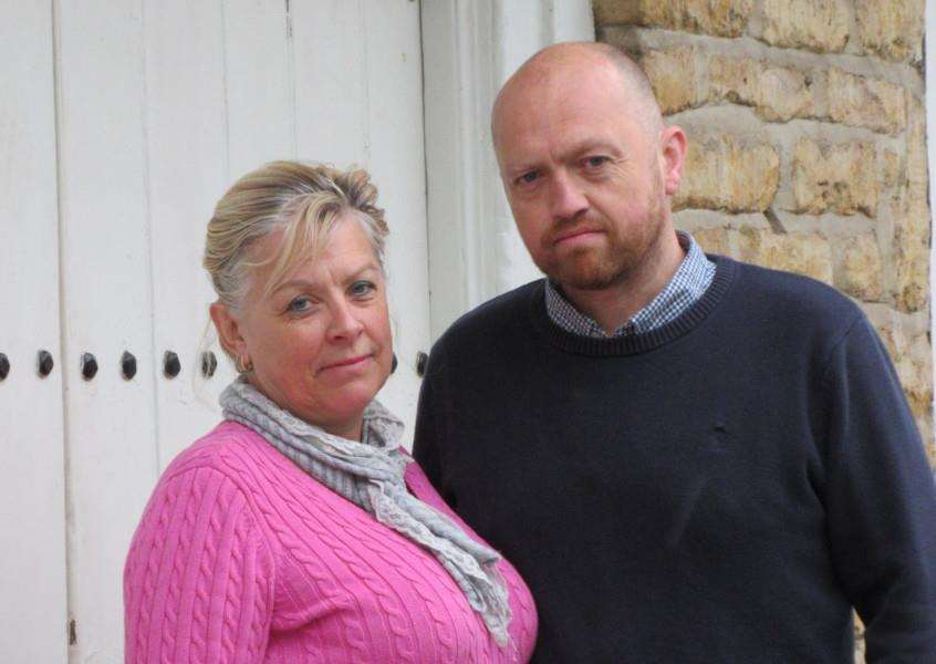 Pam Jackson and James Noll outside the St Mary's Vaults pub in Stamford, which has been closed since Tuesday