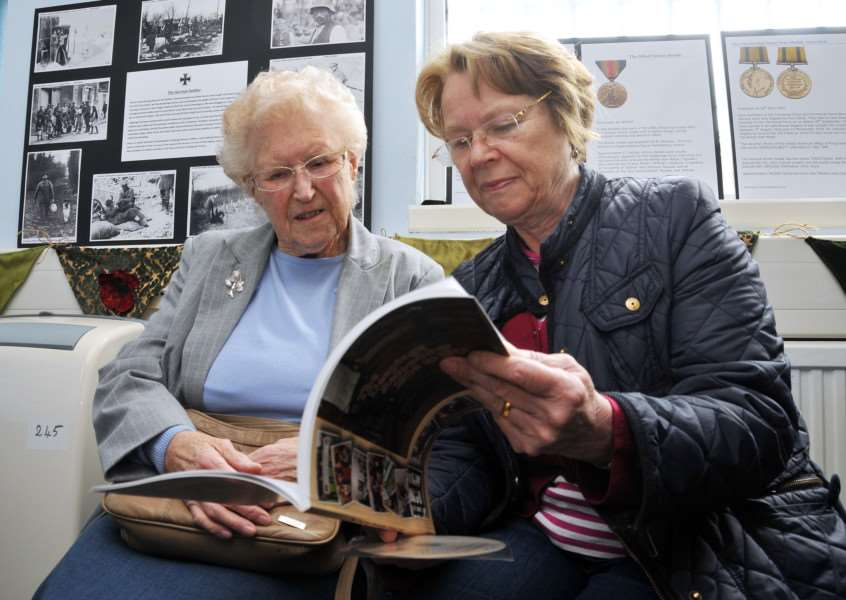 Kathleen Roffe and Maureen Plant look through the new book on World War I and its effect on the Deepings community. Photo by Tim Wilson.