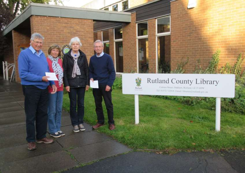 Mike and Jan Reynolds and Georgina and Chris Rowsell are pictured handing out leaflets outside the library EMN-161018-161355001