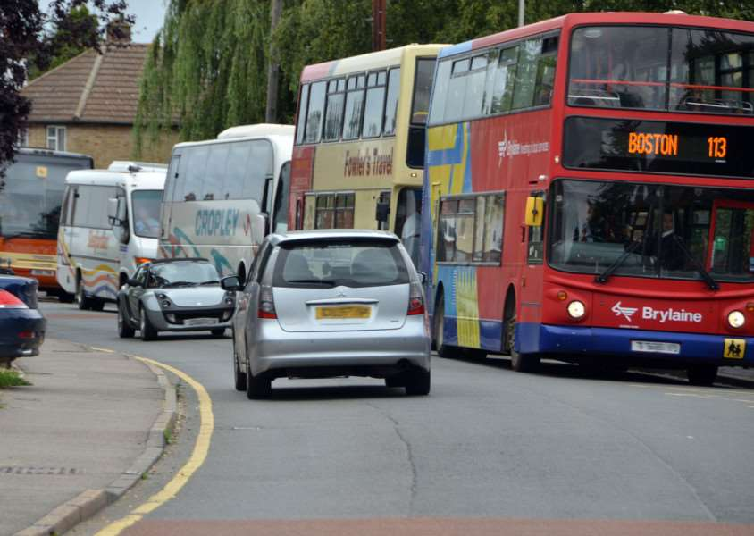 Buses waiting to take students home from Spalding Grammar School, Stongate, Spalding. Photo by Tim Wilson.