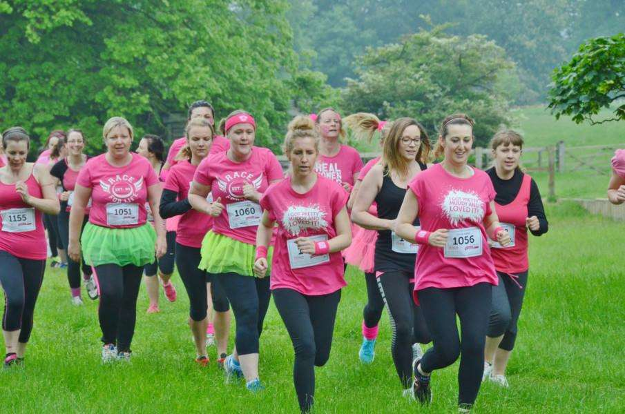 Runners in the Race for Life Pretty Muddy event at Burghley Park. EMN-160406-203621009