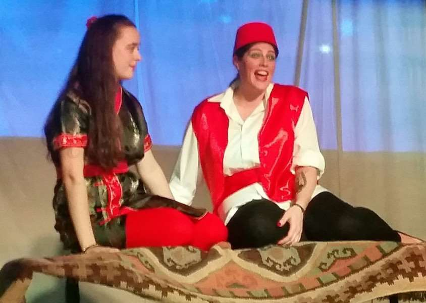 Aladdin (Rachel Eyre - left) and Princess Jasmine (Rosie Baxter) on stage at Deepings Methodist Church. Photo supplied.