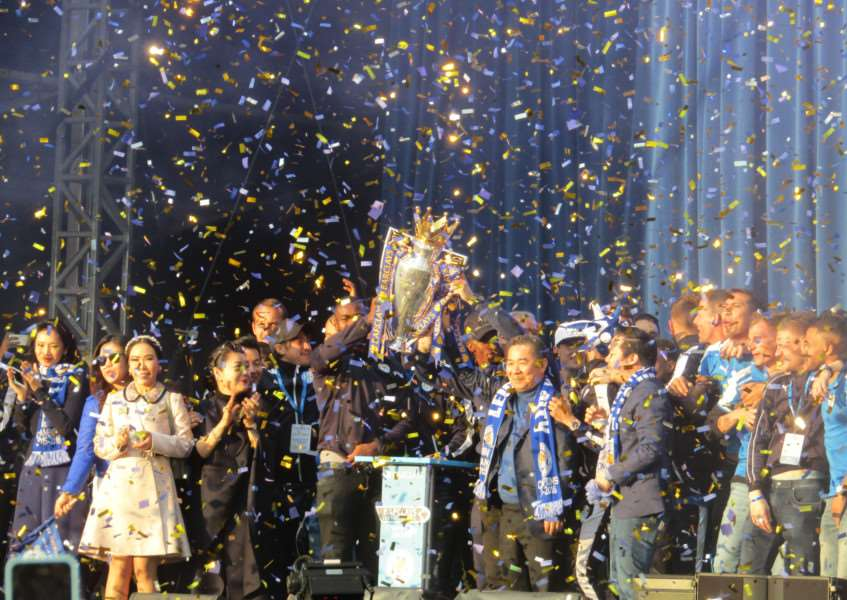 The Premier League is held aloft to the ecstacy of fans who flocked to Leicester's Victoria Park EMN-160519-133610001