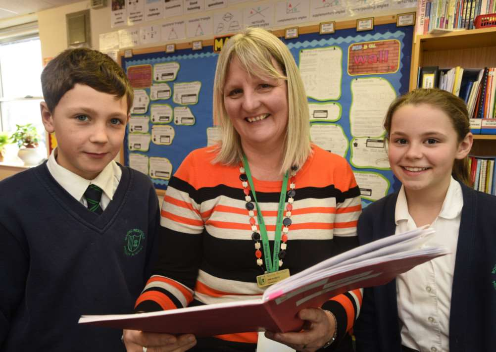 Bourne Westfield Academy head teacher Mrs E Radley with pupils Connor Ely and Sophie Walker EMN-150216-150158009