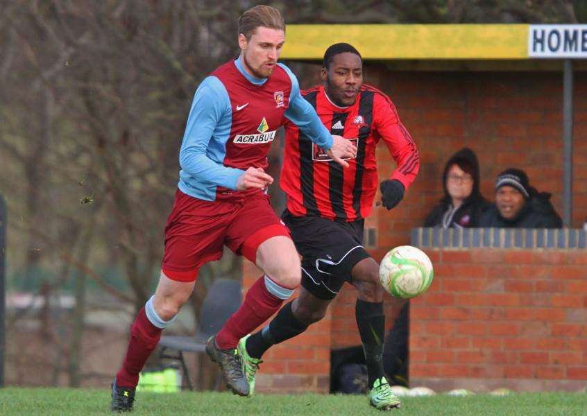 Luke Hunnings heads off the danger as Tendai Chitiza threatens the Rangers goal during the United Counties League - Premier Division match between Leicester Nirvana and Deeping Rangers at Gleneagles Avenue, Leicester. England. on 30 January 2016. Photo by Will Kilpatrick. ANL-160102-080750002