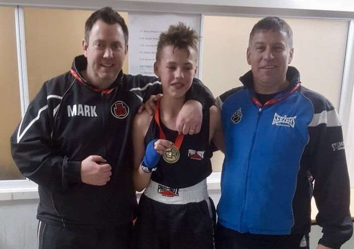 Stamford's new national schoolboys champion Freddie Brooks with coaches Mark Atherton and Darren Strange.