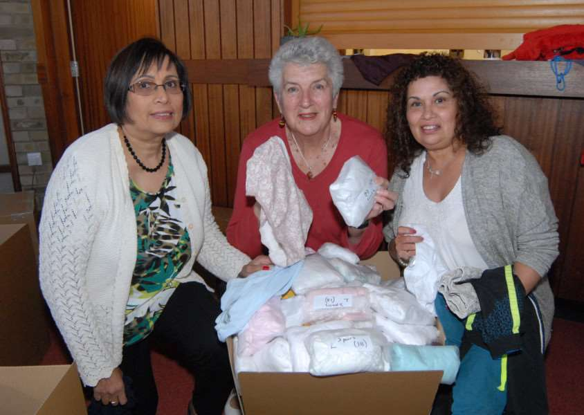 Knickers appeal: Terry Westwood, centre, with packers Yvonne D'Cruz and Ginny Kolb.'Photo: MSMP220415-003js