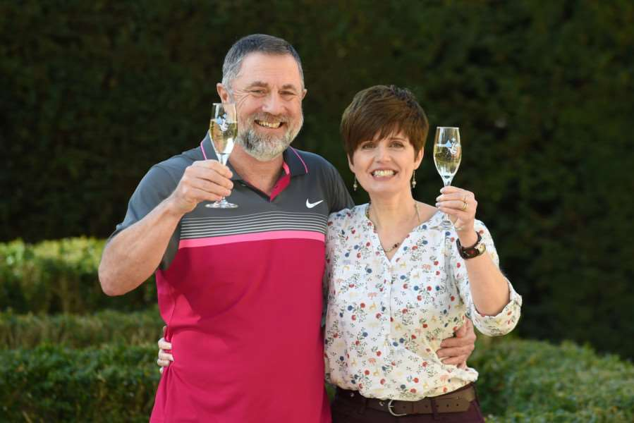 Gerry Cannings, 63, and his wife Lisa, 48, from near Peterborough, Cambridgeshire, celebrate at the city's Orton Hall Hotel after winning a �32.5 million rollover Lotto jackpot. Photo credit: Joe Giddens/PA Wire LOTTERY_Jackpot_125451.JPG
