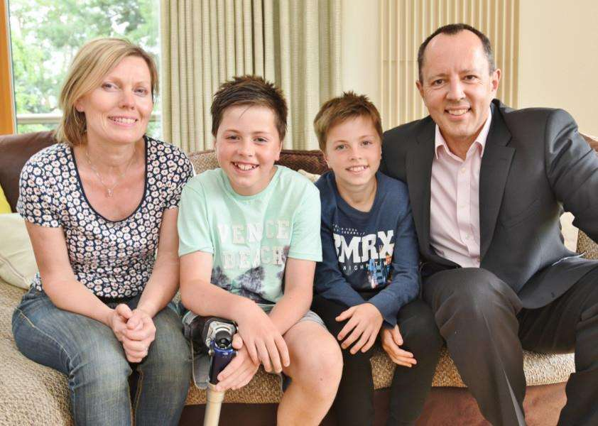Tracey and Nick Goold with their twin boys Seb and Ben (11) at their home in Wansford EMN-160308-091705009