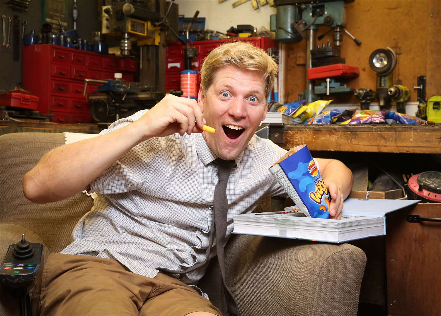 Colin Furze with Wotsits, his favourite crisps that have been hidden in a book