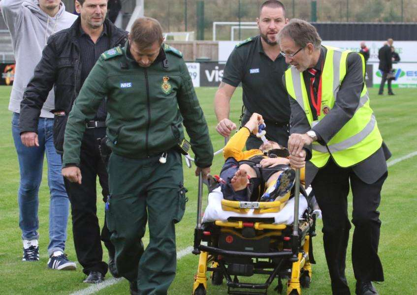 Basford United captain Jake Sheridan is treated on the pitch at the Zeeco Stadium on Saturday after breaking his tibia and fibula bones in his lower leg in a tackle against Stamford AFC. Photo: Geoff Atton EMN-161110-141115001