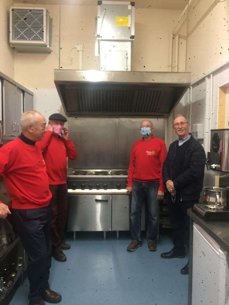 President Yim Kong (left) and members of Stamford Rotary St Martins viewing the new kitchen and ovens