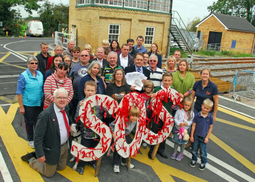 Signal box red ribbon protest Deeping St James'All with MP John Hayes centre EMN-140929-120844001