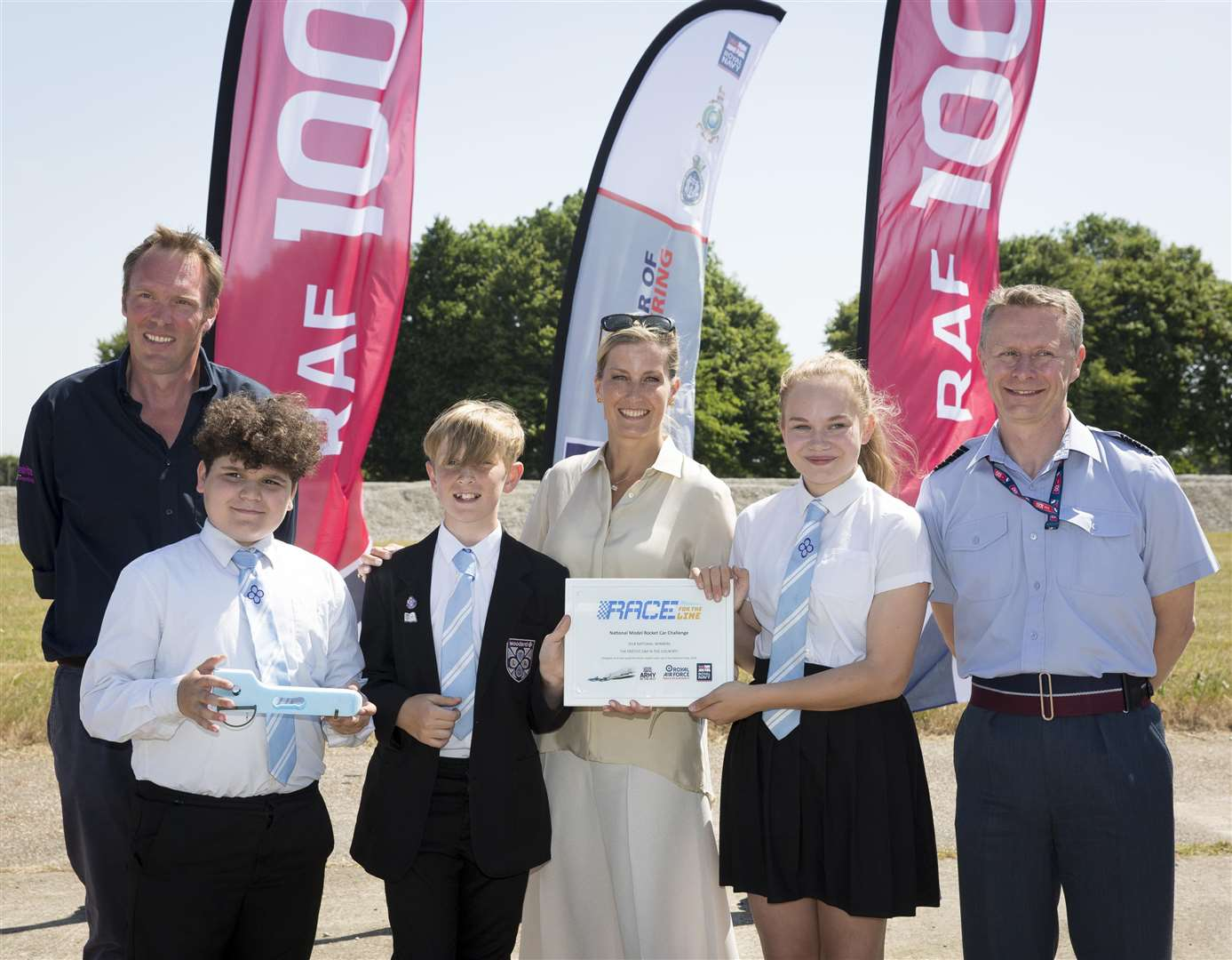 Aulden Dunipace, left, the Countess of Wessex, centre, and Group Captain Tony Keeling, right, with the winning team from Littlehampton Academy