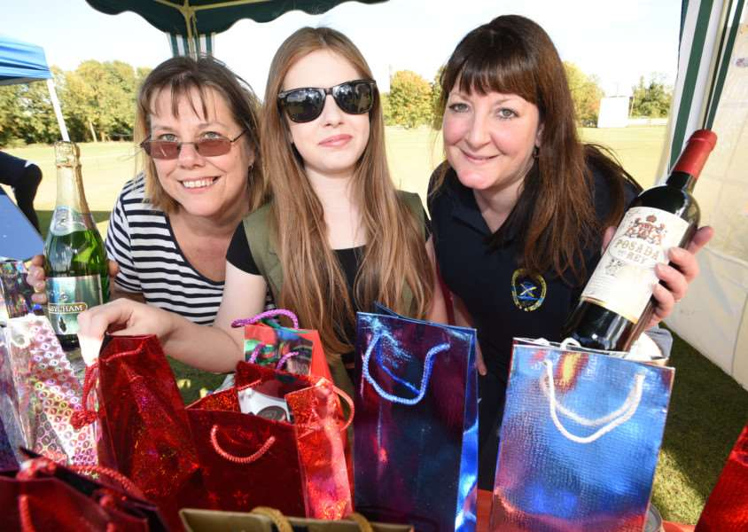 Ketton village fete. Kelly Charge, Lucy Charge and karen Thomas with their bottle stall EMN-150927-170424009