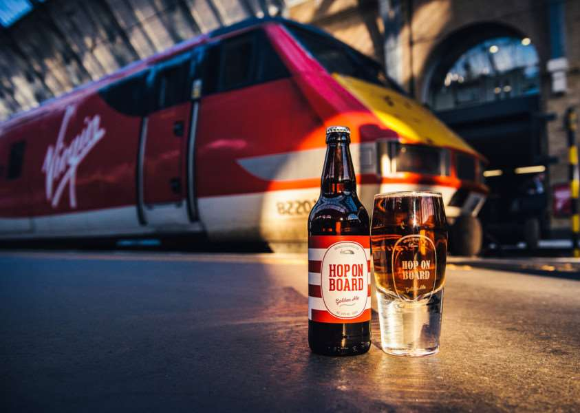 Virgin Trains on the east coast is celebrating the release of its new on board ale, 'Hop on Board', with a bespoke Hoptimist pint glass. Copyright: � Mikael Buck / Virgin Trains