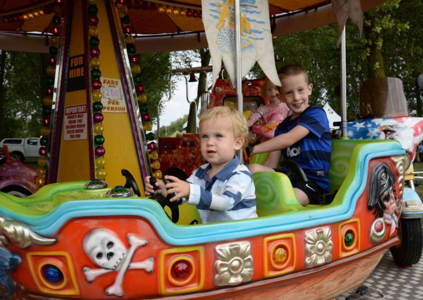 Charlie and Jacob Dear enjoy the fairground rides at Rutland Day EMN-140915-112110001