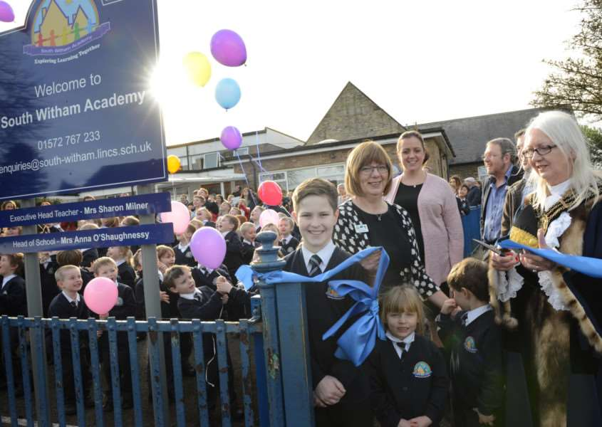 Mayor of Grantham Linda Wootten cuts the ribbon at South Witham Academy, with executive head Sharon Milner, head of school Anna OShaughnessy and governor Tim Smith and pupils Cade Barends, Myla-Rae Pinder and Taylor Coates.