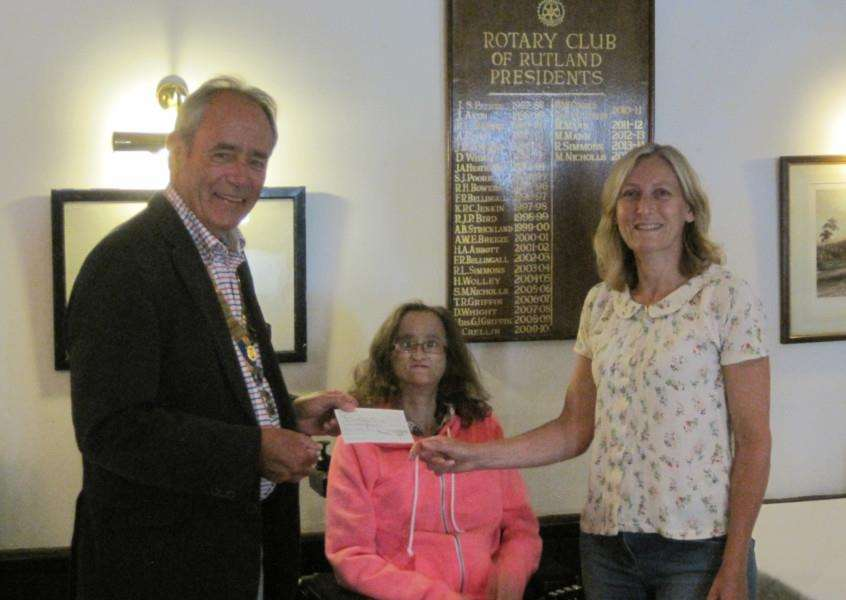 President of Rutland Rotary Mark Nicholls presents a cheque to chairman of the Rotaract Family Support Centre at the Parks School Caroline Abdul-Rahim, accompanied by Yasmeen Abdul-Rahim. EMN-150917-113521001