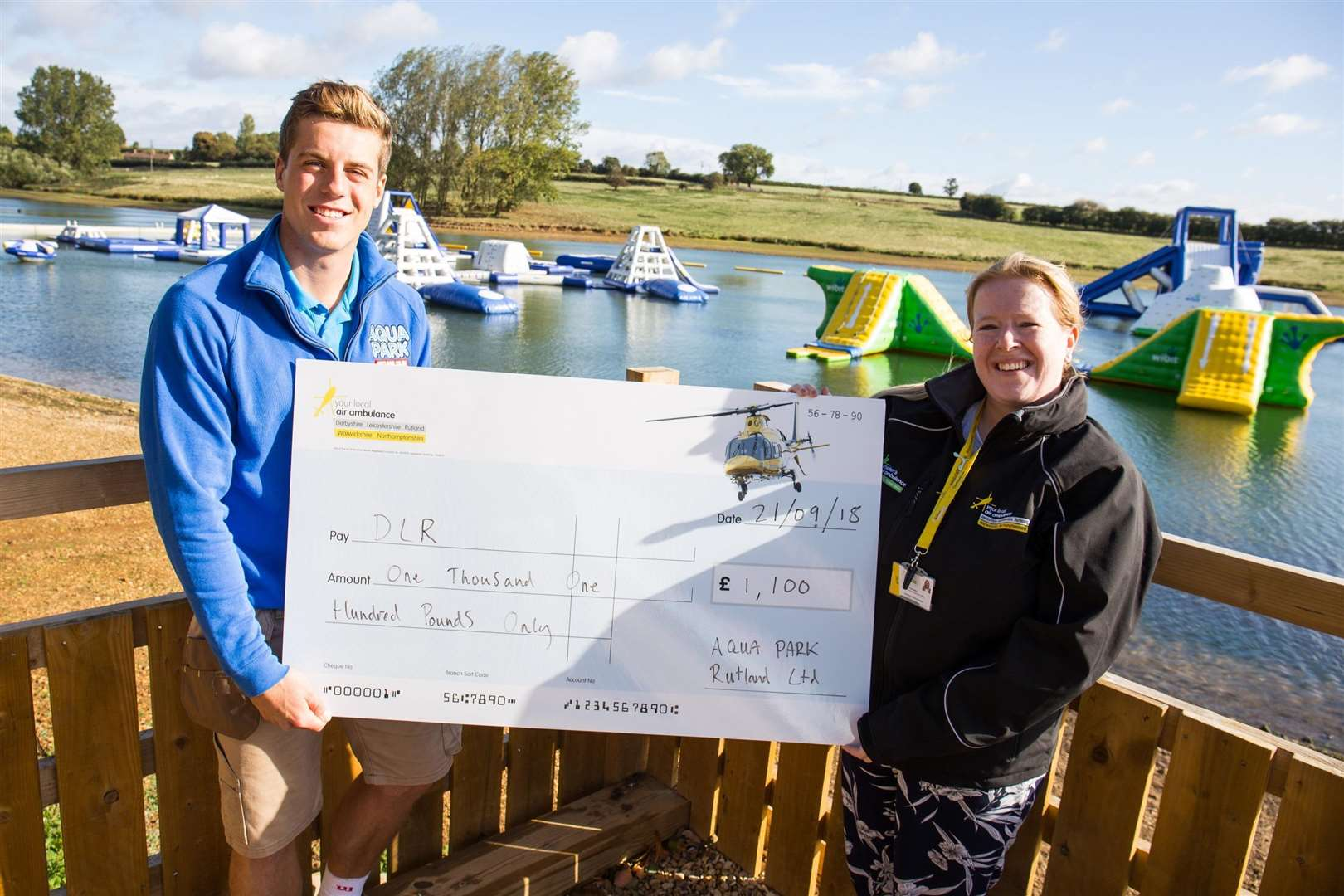 Richard Drinkwater of Aqua Park Rutland presents a cheque to Emma Cunnington of The Air Ambulance Service
