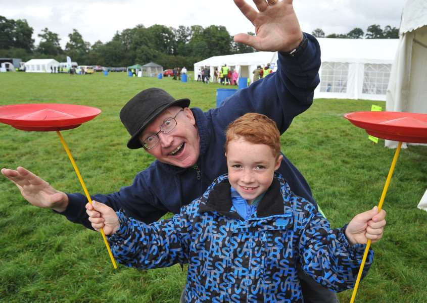Kiwanis family fun day at Burghley Park. Clive Sensible teaching Ryan Redshaw some circus tricks. EMN-141008-175108009