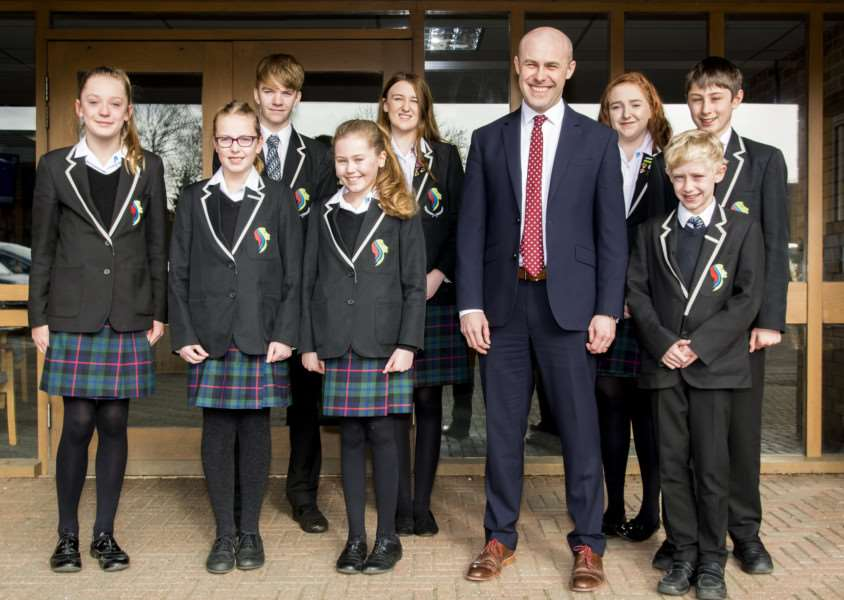 Stamford Welland Academy principal Anthony Partington celebrates a good Ofsted report with pupils'Photo: Lee Hellwing