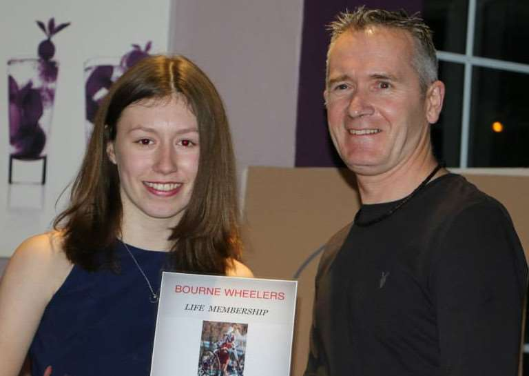 HONORARY MEMBER: Maddie is made an honorary life member of Bourne Wheelers Cycling Club by ex-national champion Jeff Snodin, her coach at the 2014 Sainsbury's School Games in Manchester. Photo supplied.