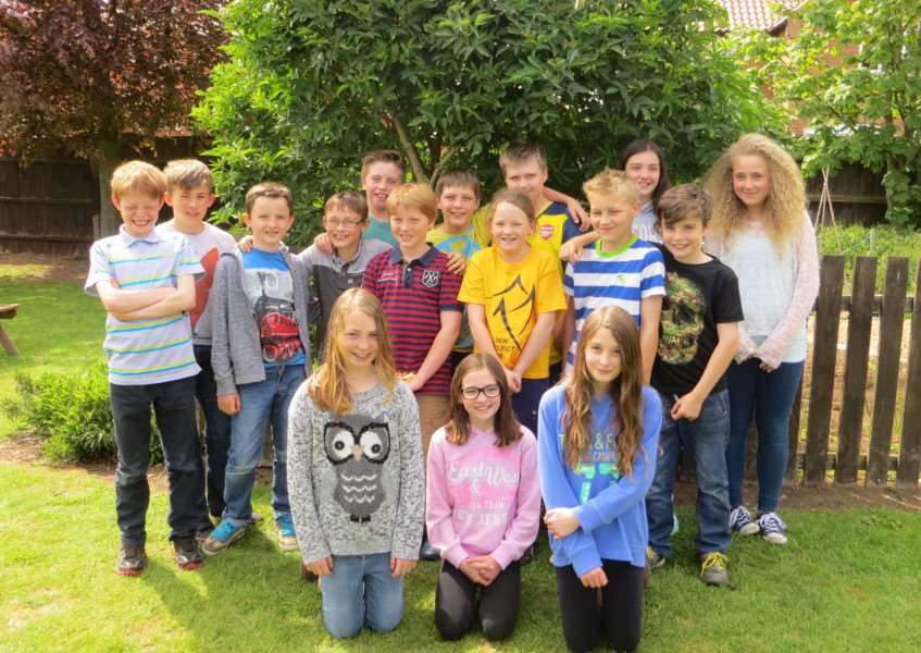 Thea Revell, aged 10, pictured centre with her classmates at Corby Glen Community Primary School. EMN-150526-154233001