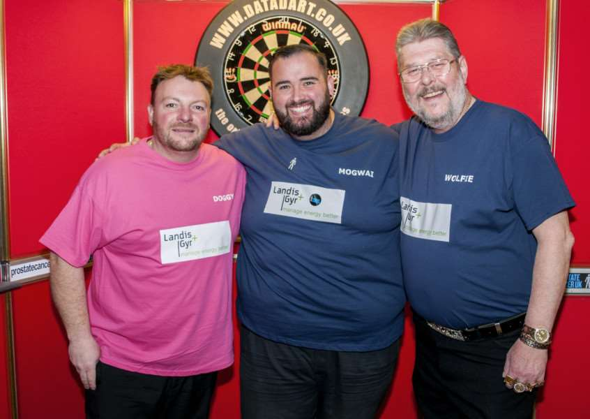 Darts players Brian Dawson, left, and Martin 'Wolfie' Adams, right, with Marc Palmer at the charity darts night