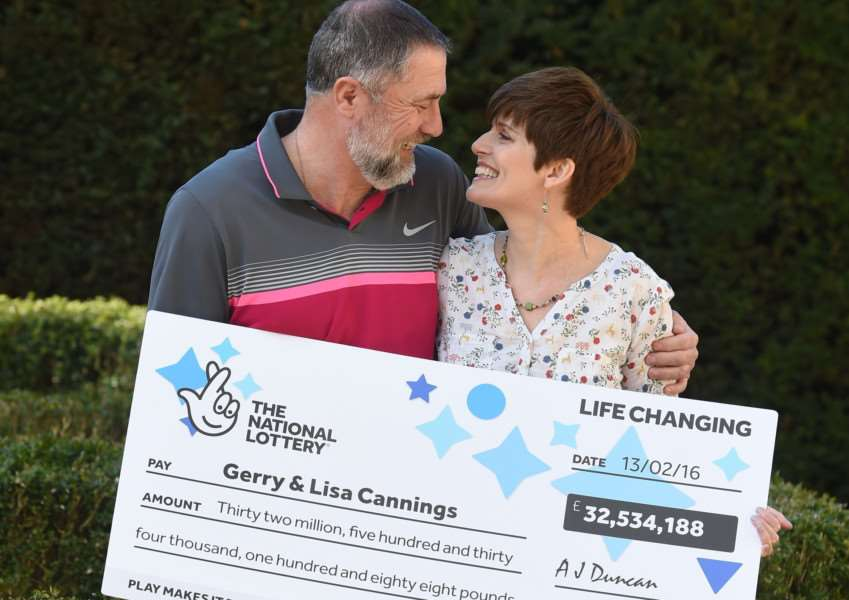 Gerry Cannings, 63, and his wife Lisa, 48, from near Peterborough celebrate at the city's Orton Hall Hotel after winning a �32.5 million rollover Lotto jackpot. Photo credit: Joe Giddens/PA Wire LOTTERY_Jackpot_125544.JPG