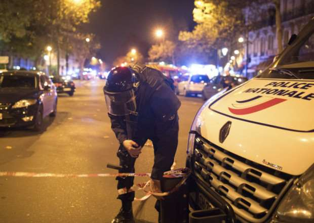 A police officer secures the area outside the Bataclan concert hall in Paris. Picture: AP