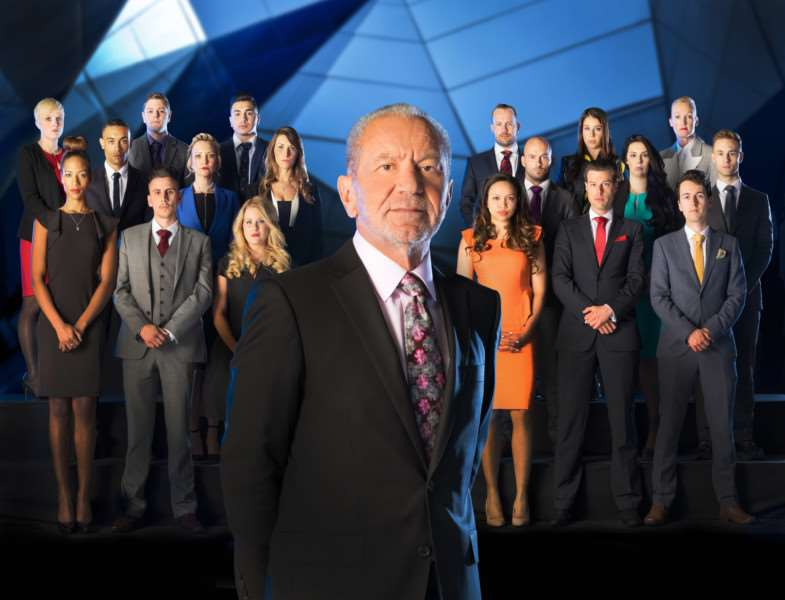 Lord Sugar and this year's Apprentice candidates (back row left to right) Natalie Dean, David Stevenson, Mergim Butaja, Richard Woods, Vana Koutsomitis, Ruth Whiteley, (second row left to right) Scott Saunders, Charleine Wain, Jenny Garbis, Brett Butler-Smythe, Elle Stevenson, Sam Curry, (front row left to right) April Jackson, Joseph Valente, Selina Waterman-Smith, Aisha Kasim, Gary Poulton and Dan Callaghan. Picture: Jim Marks/Boundless/BBC/PA Wire