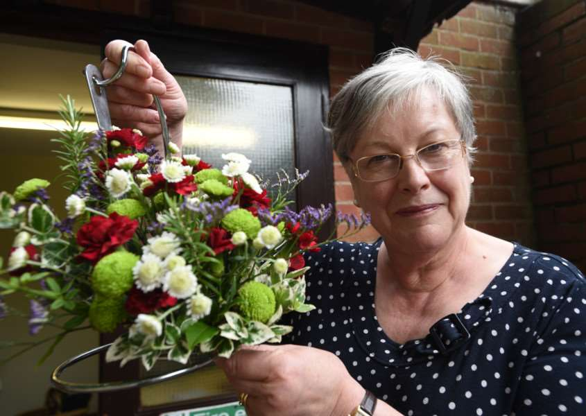 Exton produce show at the village hall. Caroleen Falconer and her floral display EMN-150908-195228009