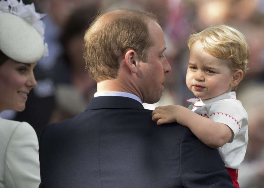 Duke and Duchess of Cambridge with Prince George at Princess Charlotte's christening at the Church of St Mary Magdalene in Sandringham. Photo: Matt Dunham/PA Wire