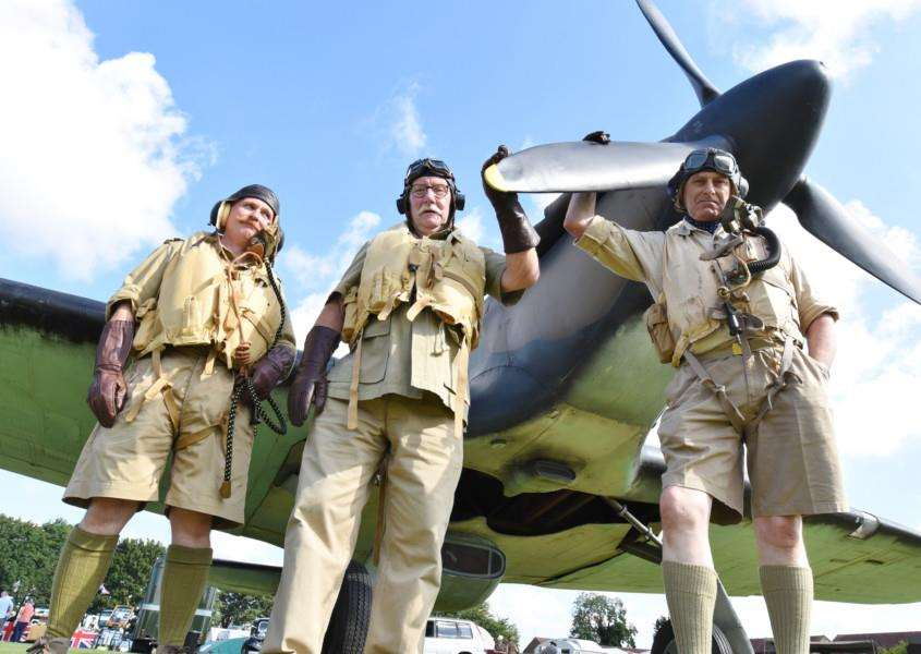 Baston Blitz 1940's weekend . Malcolm Tyas, Steve Roberts and Bob Ham from the BBMF re-enactment group with WW2 Hurricane. EMN-160608-213737009