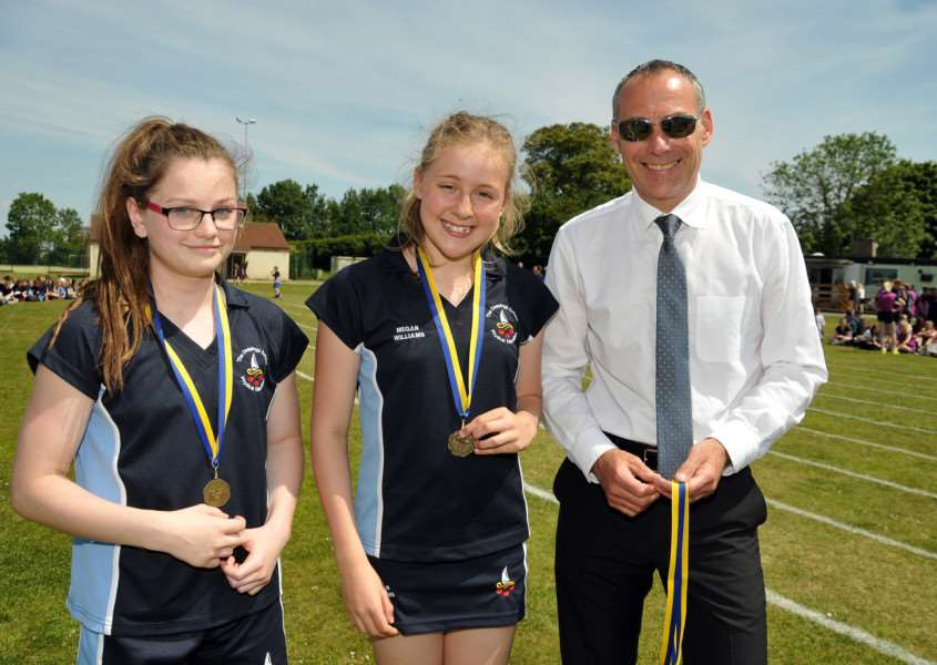 The Deepings School, Park Road, Deeping St James, annual sports day, 'Dep head Ian Ladley [resents shot medals to Emily McCann and Megan Williams ANL-151206-085730001