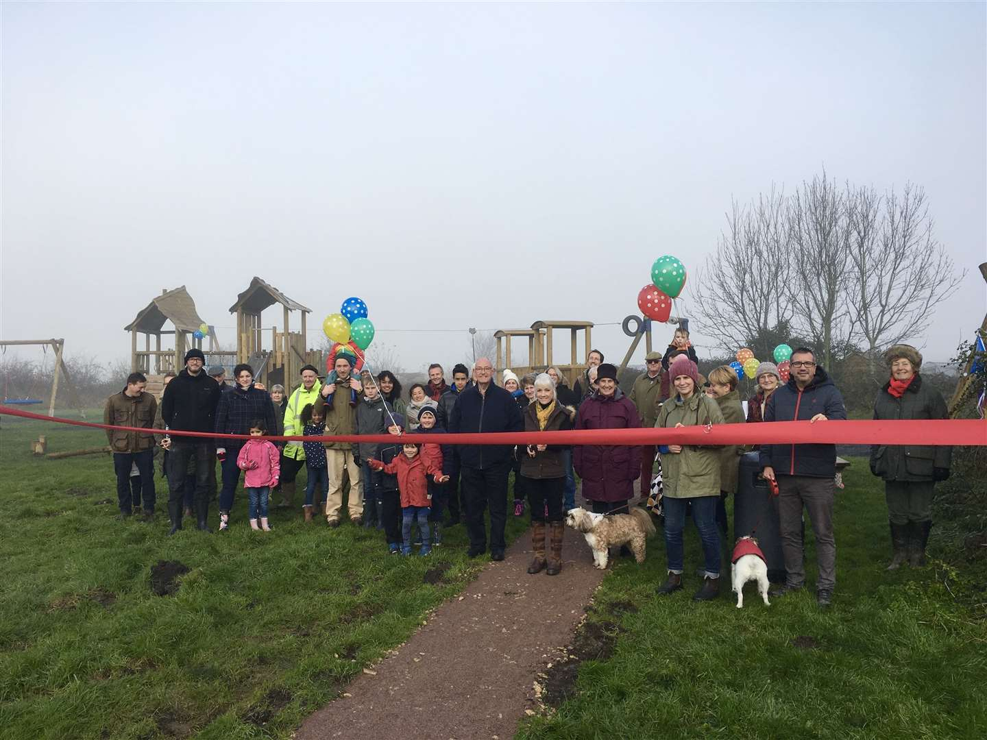 Villagers celebrate the opening of Caldecott's first ever playground.