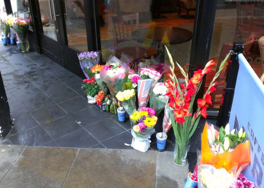 Floral Tributes to Jess Danby outside Cafe Nero.