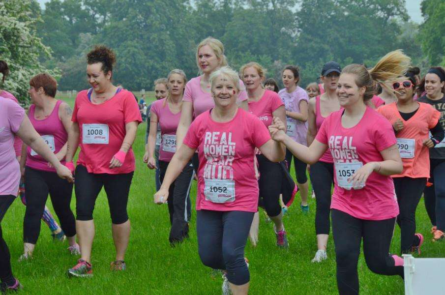Runners in the Race for Life Pretty Muddy event at Burghley Park. EMN-160406-203831009