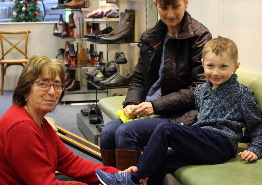 Rosemary Gray helps ensure youngster Callum Elms gets the right footwear.