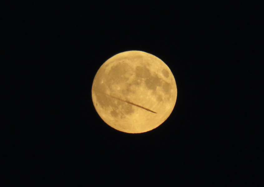 Linda Robertson from South Wootton near King's Lynn took this photo of a plane crossing the Super Moon