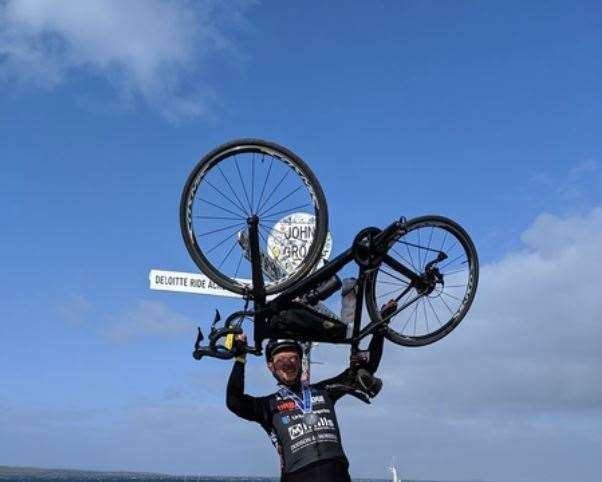 Stuart celebrates finshing his epic ride in front of the sign at John O'Groats (19286193)