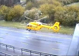 The Highways Agency photograph of the air ambulance landing on the A1