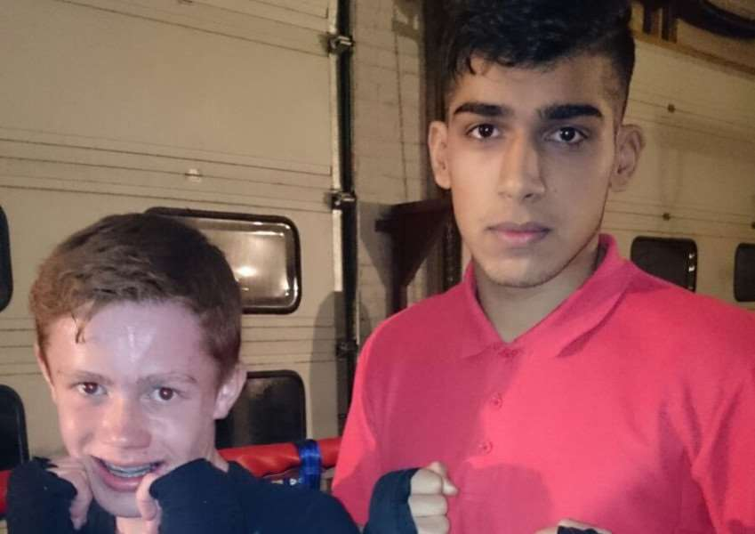Pictured left, Stamford ABC fighter, Harry Bell, 15. EMN-151215-120956001