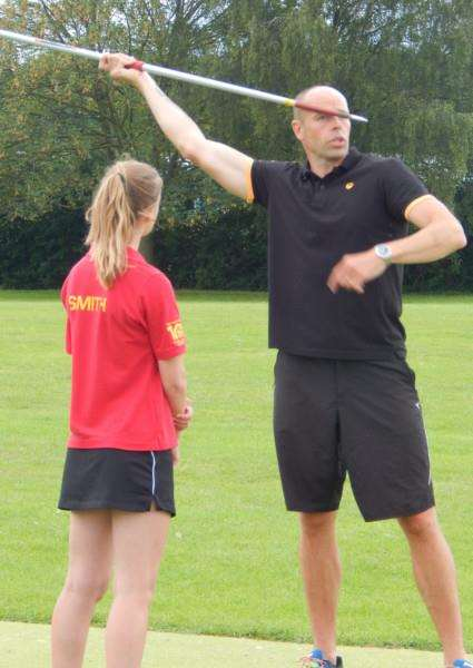 EXPERT COACHING: Year 8 student Eleanor Smith, current South Lincolnshire Schools Sports Association javelin record holder, gets some tips from Dean Macey.