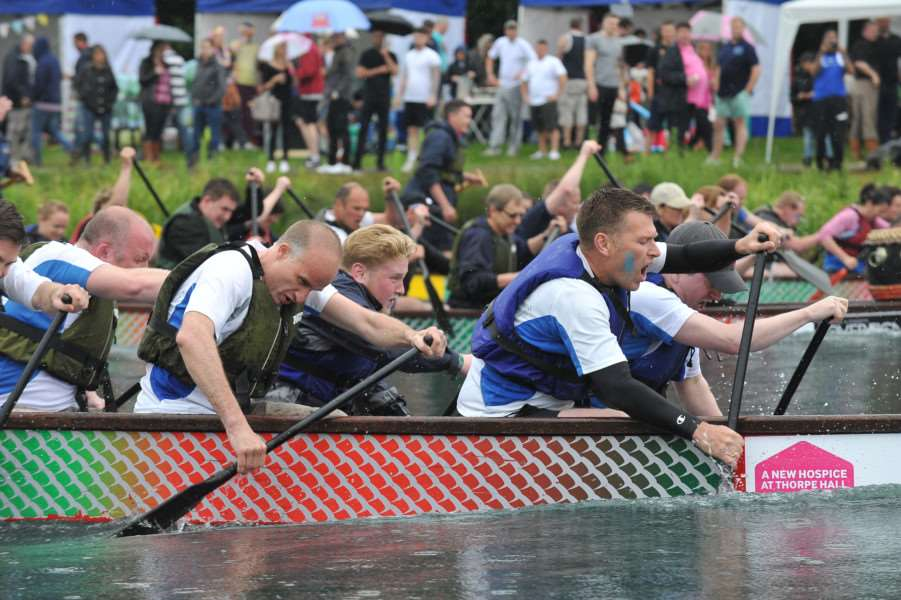 Dragon Boat racing at Thorpe Meadow. Action of the crews on the water EMN-150613-172406009