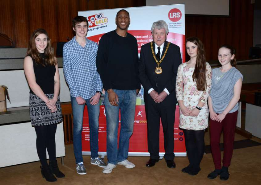 Chairman of Leicestershire County Council, David Snartt, and Drew Sullivan, Leicester Riders Forward and Team GB Captain, presenting funds to Rutland's athletes. EMN-160902-142438001