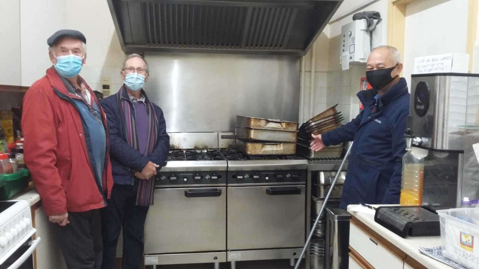 President Yim Kong (right) with Roger Adams and Geoff Collet of Stamford Rotary St Martins inspecting the old kitchen