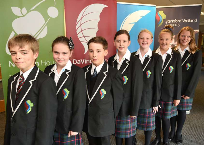 Stamford Welland Academy Year 7 pupils show off their new uniform. From left, Xander Cooke, Isabel Mae Cawser, Jasmine Emery, Mia Barlow, Ellie Deegan and Jasmine Croutter, all 11. ''Photo: David Lowndes MSMP-10-09-15-dl001 EMN-151009-120210001